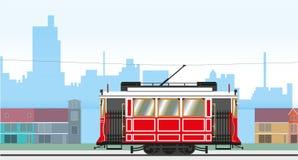 Stadtbild mit einer Retro- Tram, die vorbei überschreitet Auch im corel abgehobenen Betrag vektor abbildung