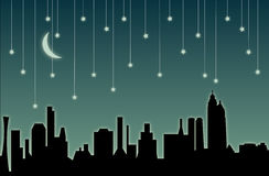 Stadtbild u. fallende Sterne Stockfotografie