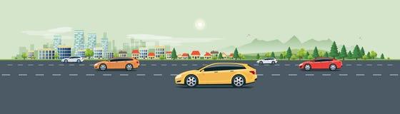 Stadtlandschafts-Straßen-Straße mit Autos und Stadt-Natur-Hintergrund Lizenzfreie Stockfotografie
