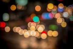 Stadtlicht-Unschärfe bokeh, defocused Hintergrund Stockbilder