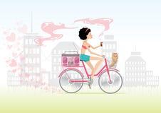 Stadtmädchen in der Liebe auf Fahrrad mit Welpen Stockfotografie