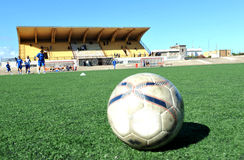 Football stadium. With ball on synthetic grass stock photography