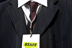 Staff. Member concept:  label on badge and business suit stock image