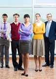 Staff. Photo of confident managers standing in office with young lady in front Stock Photo
