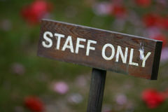 Staff only. A sign in a park stock photography