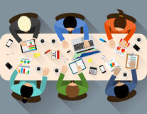 Staff around table Royalty Free Stock Photography
