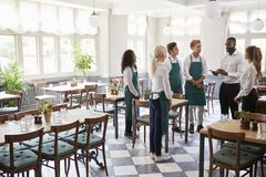 Staff Attending Team Meeting In Empty Dining Room royalty free stock image