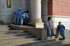 Staff of Cairo museum has rest on entrance porch. Cairo, Egypt - November 11, 2006: The Egyptian Museum in Cairo, one of the most famous museums of the world Royalty Free Stock Photography