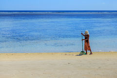 Staff in cleaning debris brought by the sea beach Royalty Free Stock Photography