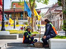 Staff cleaning,Sitting and resting,In Temple,Bangkok,Thailand royalty free stock images