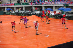 Staff clearning tennis court after the rain on Davis Cup, BELGRADE, SERBIA JULY 16, 2016 Stock Photography