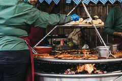 Staff cooking german sausages at Winter Wonderland, London, UK Royalty Free Stock Photography