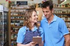 Staff In Delicatessen Using Digital Tablet royalty free stock photography