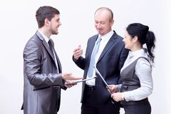 Staff discuss business documents,standing in the lobby of the office. Photo with copy space stock photography
