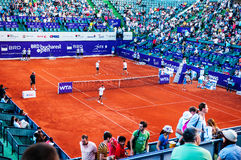 Staff doing the maintenance of the clay sourface at Bucharest Open WTA. July the 11th, 2014, tennis match between Simona Halep and Lara Arruabarrena Stock Image