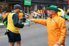 Staff giving water to runner on Chicago marathon event Stock Photo