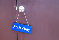 Staff Only hanging the door. Before office Stock Photo