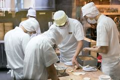 Staff making traditional chinese pork dumpling Royalty Free Stock Photos