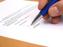 Staff manager signing a letter. In response to a job application Stock Photo