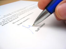 Staff manager signing a letter. In response to a job application Stock Photography