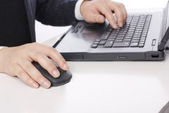 Manipulating laptop workers. The staff is manipulating the close-up of the laptop Royalty Free Stock Photos