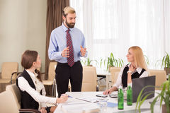Staff meeting in business meeting room Royalty Free Stock Photos