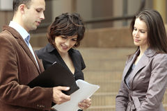 Staff meeting on the move. Business talking at a staff meeting or with a client looking at the contract Stock Photos