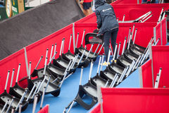 Staff overturns chair during the rain on tennis court on Davis Cup, BELGRADE, SERBIA JULY 16, 2016 Stock Images