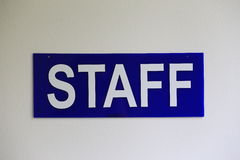 Staff plate. White staff plate on blue background Stock Image