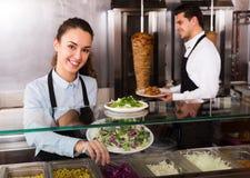 Staff posing at kebab counter Royalty Free Stock Image