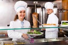 Staff posing at kebab counter Royalty Free Stock Photos