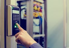 Staff push down electronic control machine with finger scan to access the door of control room or data center. The concept of data. Security or data access stock images