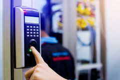 Staff push down electronic control machine with finger scan to access the door of control room or data center. The concept of data. Security or data access stock photos