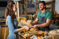 Staff receiving payment from the customer. In bakery shop Stock Photos