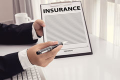 Staff recommended the benefits of insurance coverage Stock Image