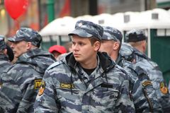 Staff of the Russian police protects political procession. Moscow, Russia - May 9, 2012. March of communists on the Victory Day. Staff of the Russian police Royalty Free Stock Photo