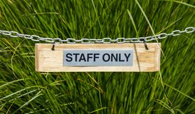 Staff Only Sign. Staff only sing hanging on a chian royalty free stock photo