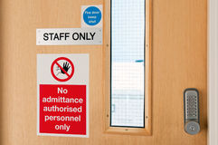 Staff only signs at laboratory. Staff only door signs outside laboratory room with security door lock keypad Stock Photos