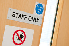 Staff only signs at laboratory. Staff only door signs outside laboratory room to assure health and safety in the workplace (shallow DOF Royalty Free Stock Images