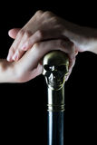 Staff with skull Holding in woman hand on black background , Wit Stock Images