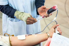 Staff taking blood sample Stock Photography