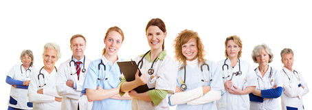 Staff team of doctors and nurses. Staff team of many doctors and different happy nurses smiling royalty free stock images