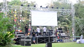 Staff test and prepare stage for concert of staff party at garden stock video