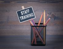 Staff Training concept. A small blackboard chalk and colored pencil on wood background.  Stock Photos