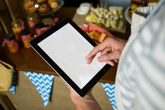 Staff using digital tablet in grocery shop Royalty Free Stock Image