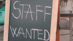 Staff wanted chalk board sign. Vacancy sign on black chalkboard. Headhunter concept. Job hire concept. Staff wanted chalk board sign. Vacancy sign on black stock video