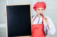 Staff wanted. Looking for colleagues. Woman chef hat apron hold blackboard copy space. Chef job position. Cooking royalty free stock photos