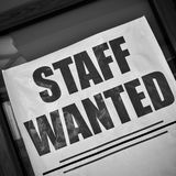 Staff wanted poster. Staff wanted - job vacancy poster in a show-case. Black and white stock images