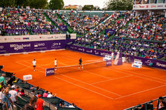 Staff watering the clay sourface at Bucharest Open WTA. July the 11th, 2014, before tennis match between Simona Halep and Lara Arruabarrena Stock Image