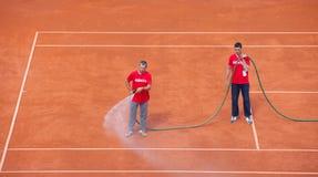 Staff waters tennis court on Davis Cup, BELGRADE, SERBIA JULY 16, 2016 Stock Image